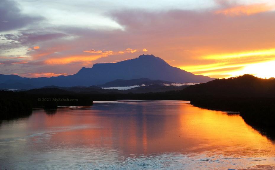 Sunrise over Mount Kinabalu at Mengkabong River Bridge