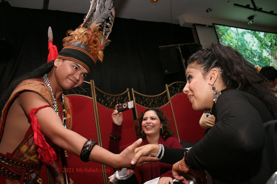 Murut warrior invites a lady to dance