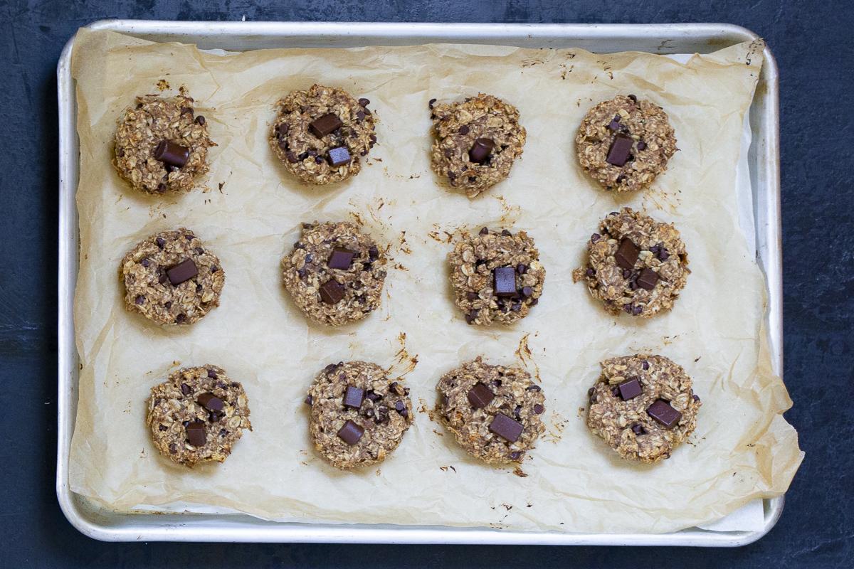 banana chocolate chip breakfast cookies on a baking sheet