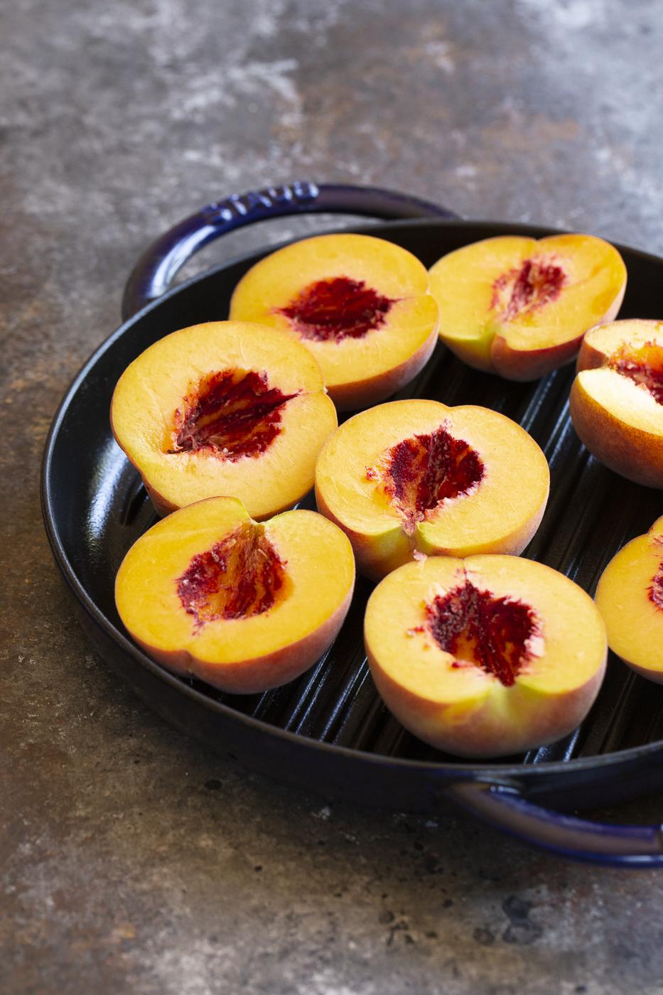 peach halves ready for crisp topping
