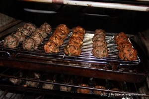homemade meatballs baking on rack