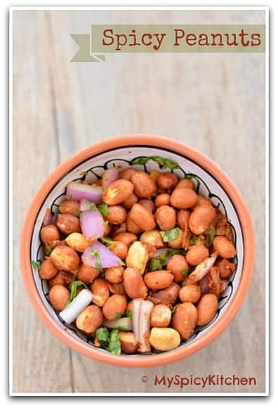 a bowl of Microwave roasted spicy peanuts or veinchina pallilu for a quick snack ,