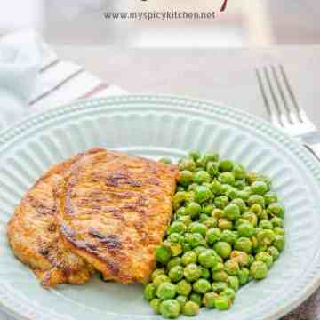 Plated 3 ingredient pork chops and english peas.