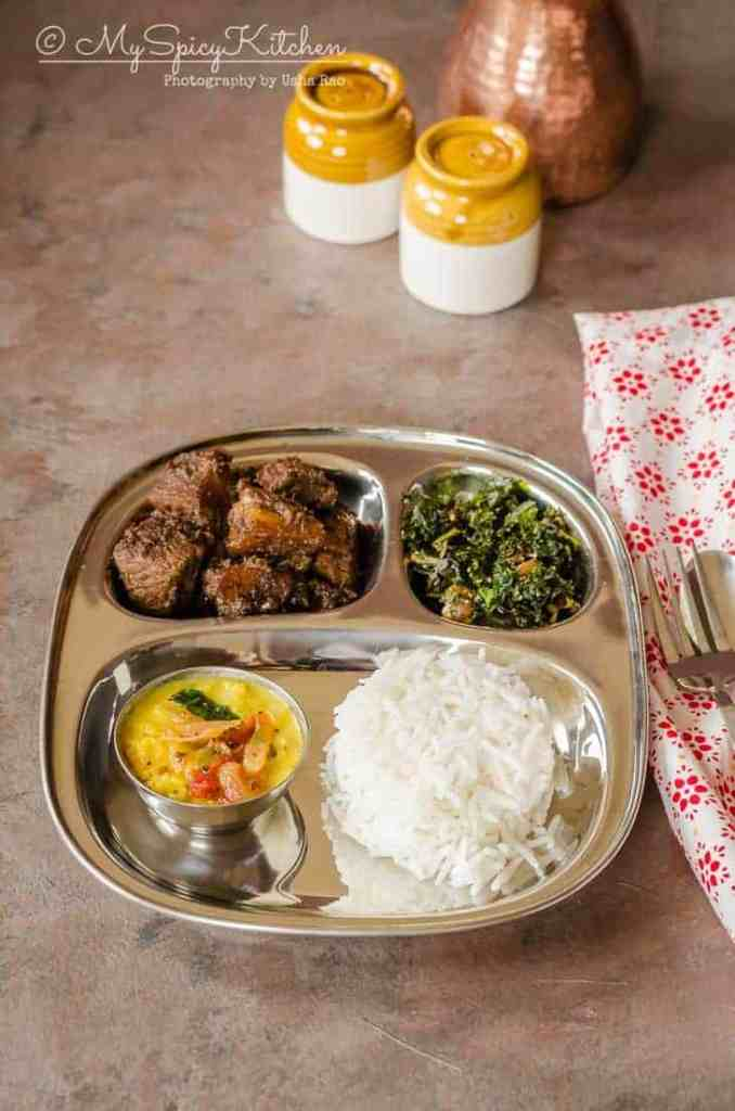 Sri Lankan platter with rice dhal curry kale mallung and pork curry