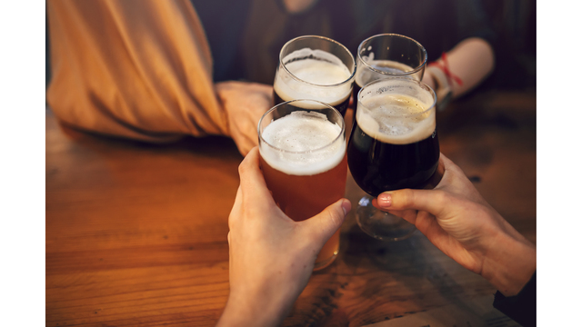 Hands Of People Holding Beer And Cheering In Brewery Pub. People_1552396436272
