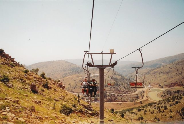 Sometimes we go to unique places. Here tour guide Arie Bar David (right), rides with one of our guests as the group travels up Mount Hermon on a ski lift. Unfortunately, we didn't find much snow in the summer, but we had a fantastic view of northern Israel, Syria and Lebanon. .
