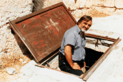 Tour Guide Arie Bar David leads Dr. Bill one of three traditional tombs of John the Baptist in Samaria. The others are said to be in Jerusalem and Damascus. (1999)