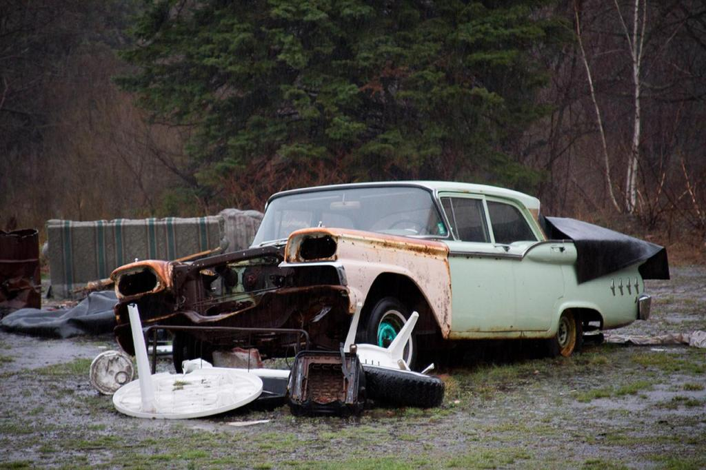 A Plymouth Fury sits in front of an active body repair shop in Centralia.