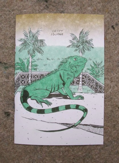 """Crypt Iguana"" risograph comic and zine front cover showing an iguana basking on top of a mausoleum"