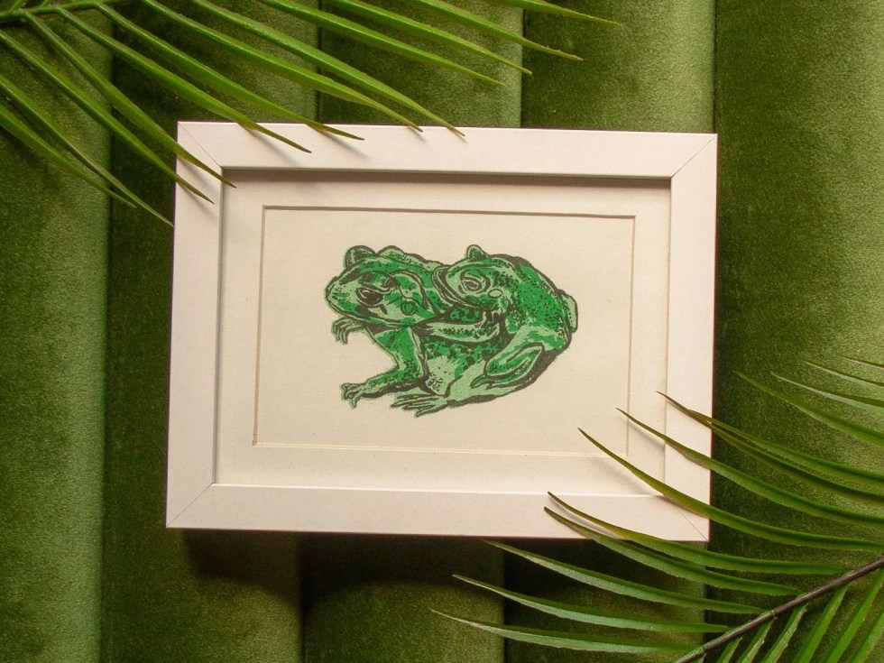 Endangered Houston Toad Couple risograph framed print showing two green frogs, one on the larger's back