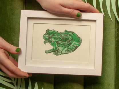 Endangered Houston Toad Couple risograph print showing two green frogs, one on the larger's back