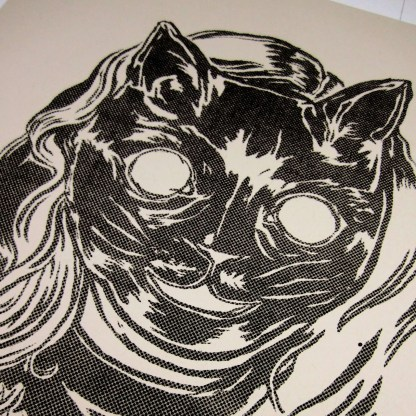 Detailed photo of risograph art print kuro neko / black cat