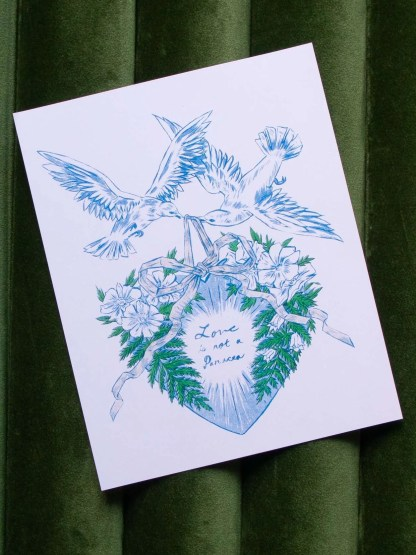 """Love is not a Panacea"" art print showing doves holding an ornament decorated in flowers by ribbon"
