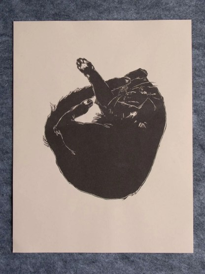 """Baby Kitty"" risograph art print showing a curled up black cat illustration on brown paper"