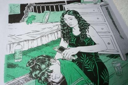 Closeup of woman shaving woman's nape