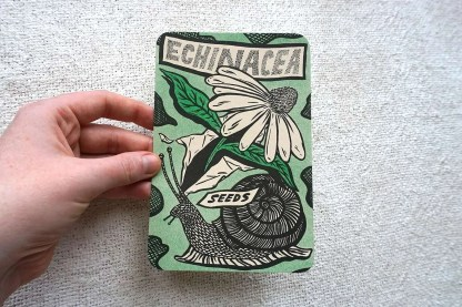 Echinacea seed packet art with snail