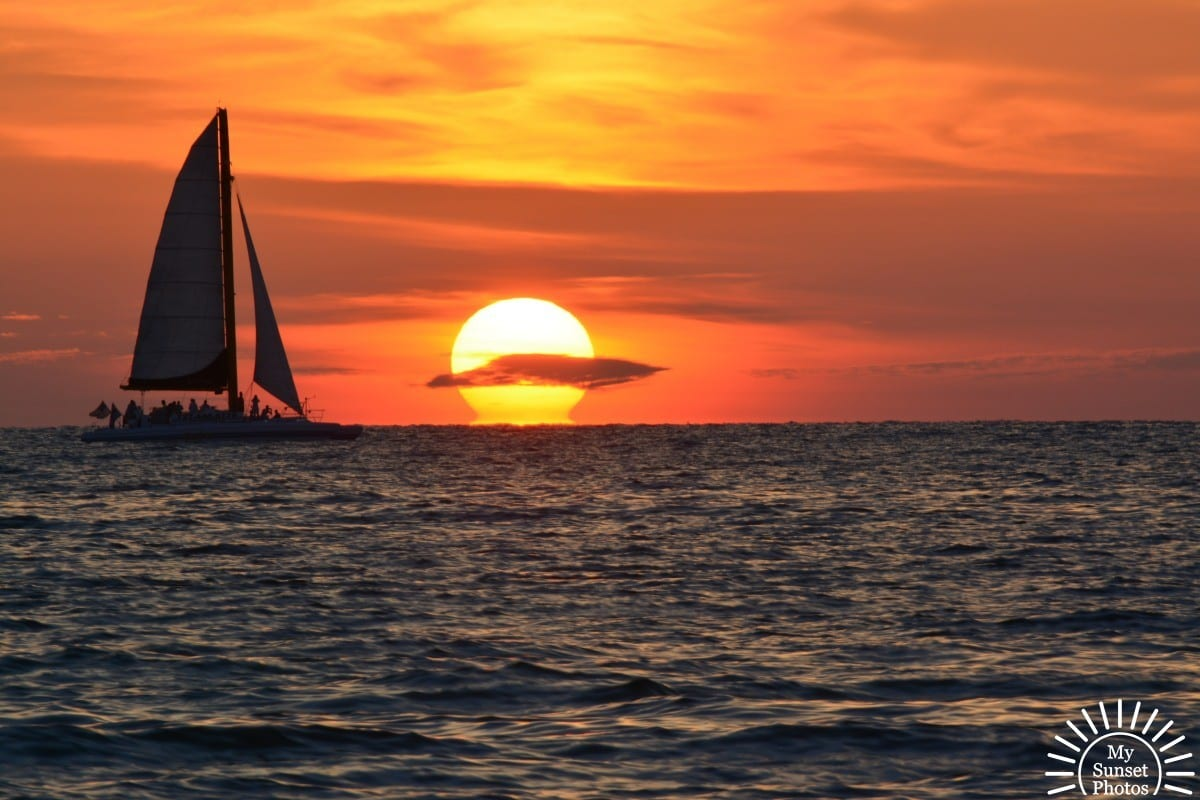 clearwater beach sunset with sailing boat and sun – my sunset photos