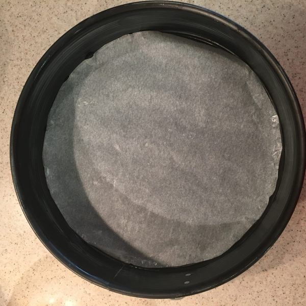 "Preheat the oven to 350 °F (180 °C). Line the bottoms of two identical 10"" round pans.