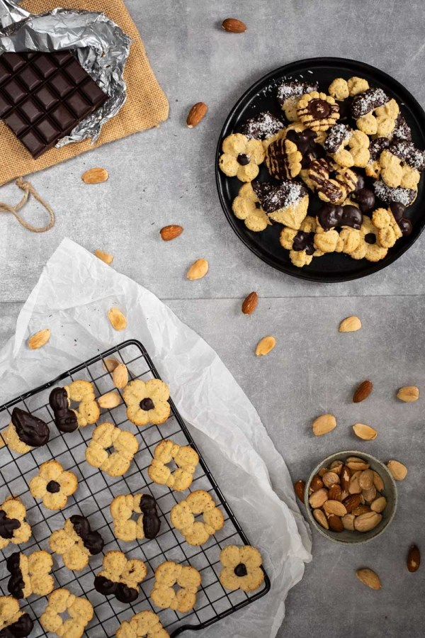 These keto almond spritz cookies are made using a cookie press. They are beyond simple to make, delicious, and baked in practically no time! #lowcarb #keto #ketogenic