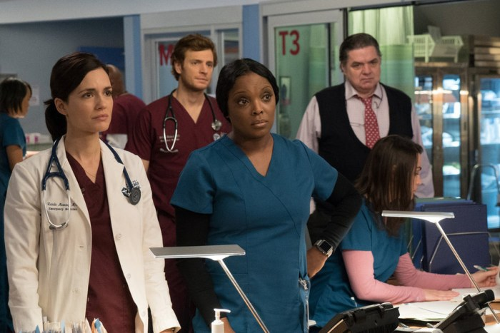 "CHICAGO MED -- ""Reunion"" Episode 108 -- Pictured: (l-r)  Torrey DeVitto as Dr. Natalie Manning, Marlyne Barrett as Maggie Lockwood, Nick Gehfuss as Dr. Will Halstead, Oliver Platt as Dr. Daniel Charles -- (Photo by: Elizabeth Sisson/NBC)"