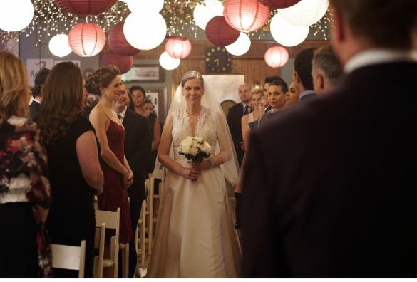 "Nerves abound as Randall ""Mouch"" McHolland (Christian Stolte) and Trudy Platt (Chicago P.D.'s Amy Morton) make it official when they walk down the aisle at Molly's in front of friends, family and colleagues. The pair become husband and wife in next week's episode of ""Chicago Fire,"" titled ""On the Warpath,"" airing Tuesday April 5 (10-11 p.m. ET). Elizabeth Morris/NBC"