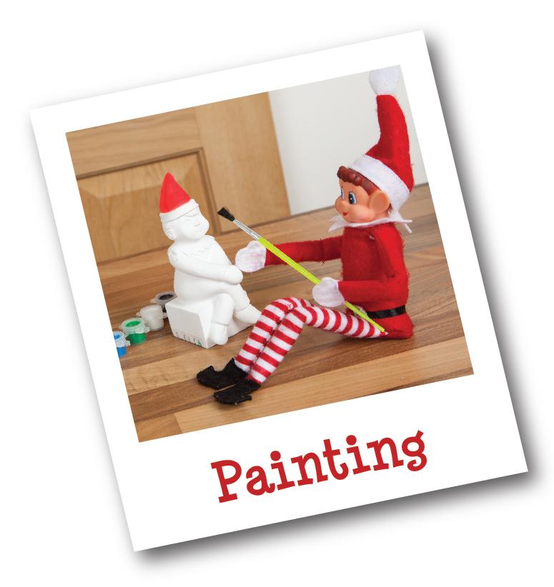 Elf painting a plaster cast elf