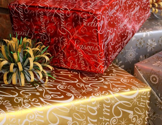 A Pile of Christmas Gifts in gold, red and silver wrapping paper