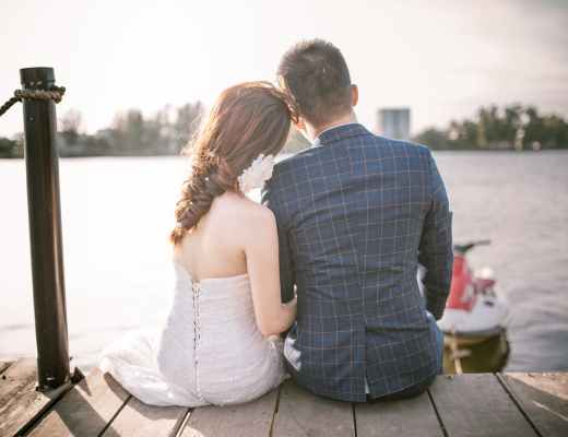 newly weds sat on a pier