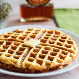 Basic waffles topped with butter and syrup