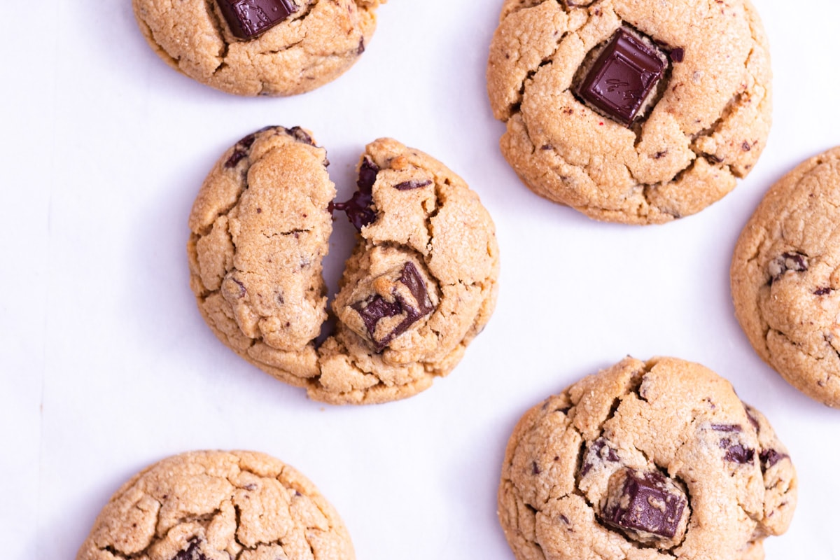 Overhead closeup shot of a cluster of peanut butter chocolate chip cookies.