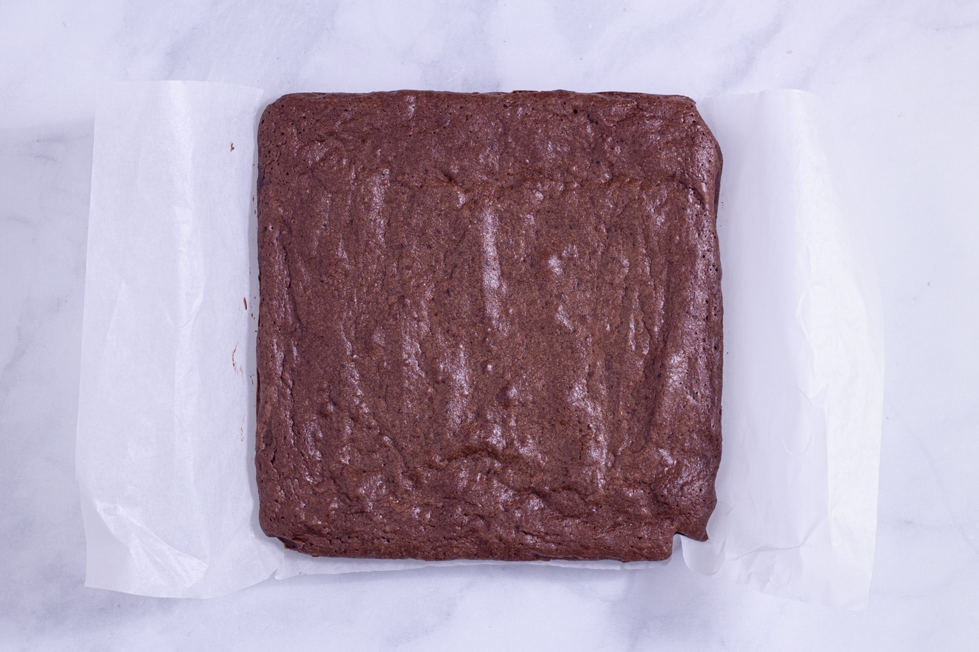 Overhead view of a square block of brownies made with reduced red wine.
