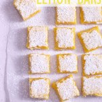 Overhead view of cut lemon bars on parchment.