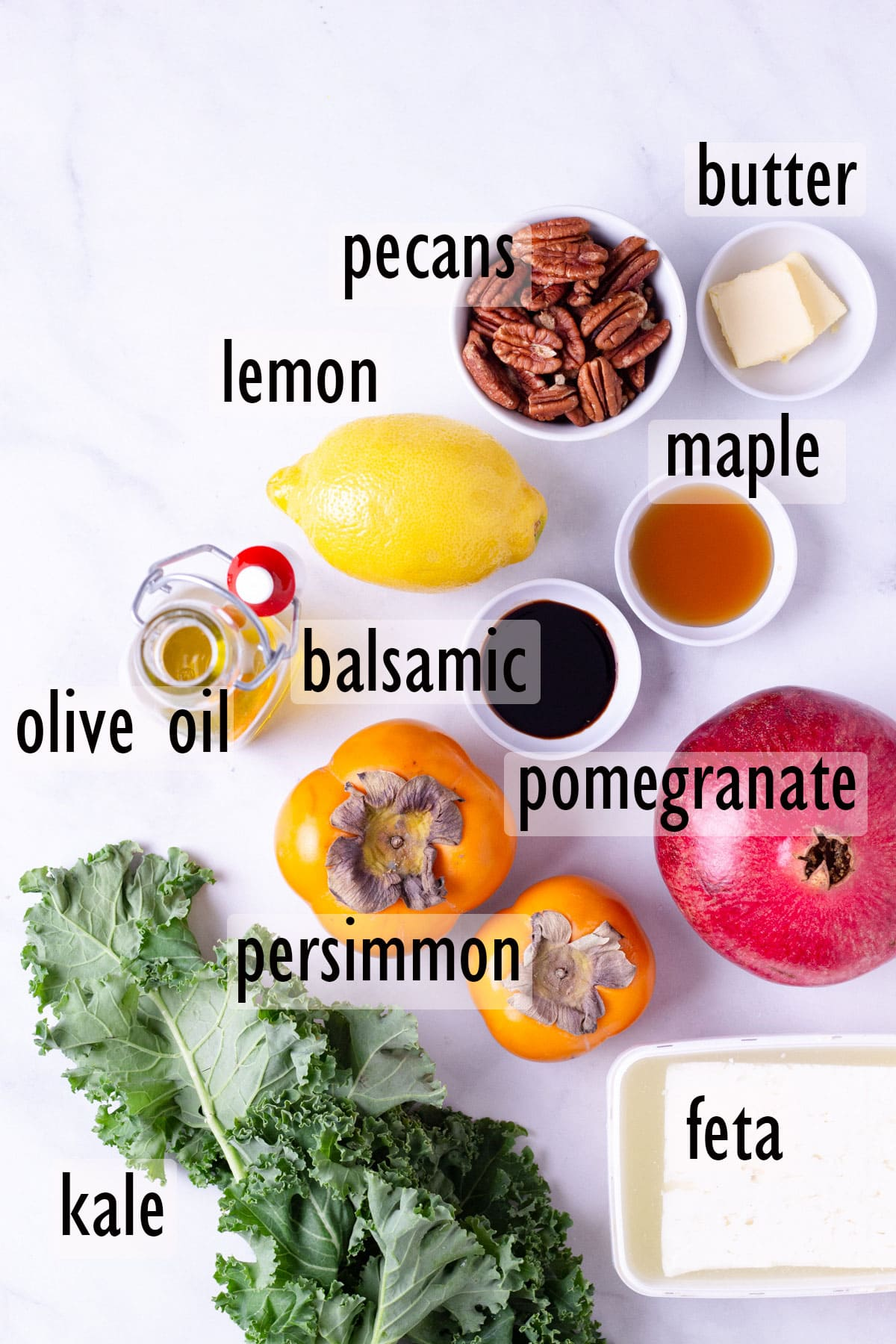 Ingredients for Pomegranate, Kale and Persimmon Salad, including nuts, cheese and balsamic vinegar.