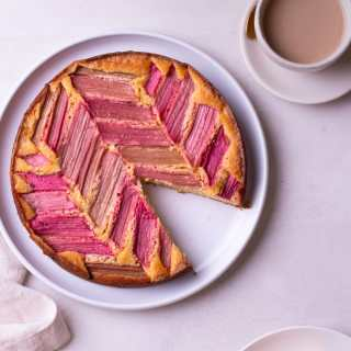 Overhead view of Rhubarb Cake with a slice cut out of it.