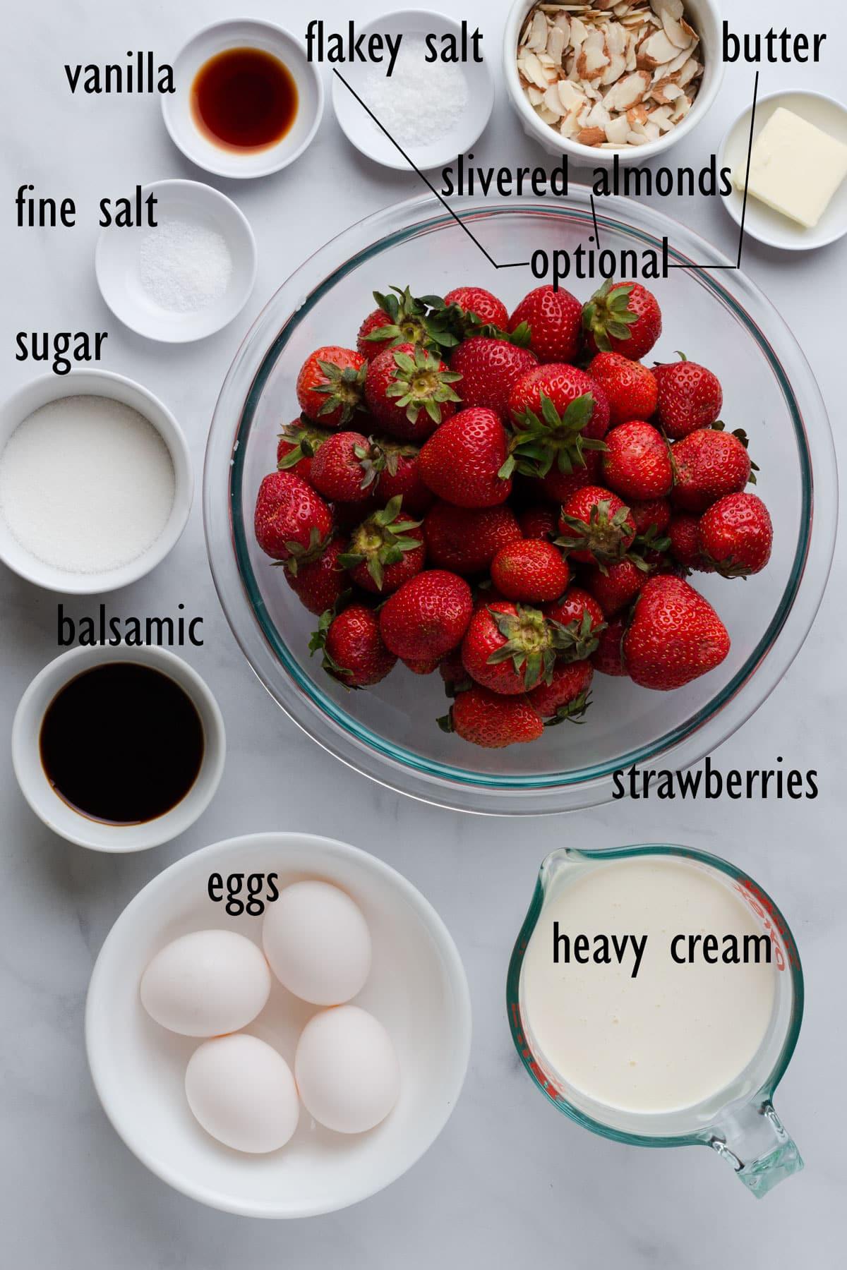 Ice cream ingredients, including strawberries, balsamic vinegar, eggs, cream and sugar.