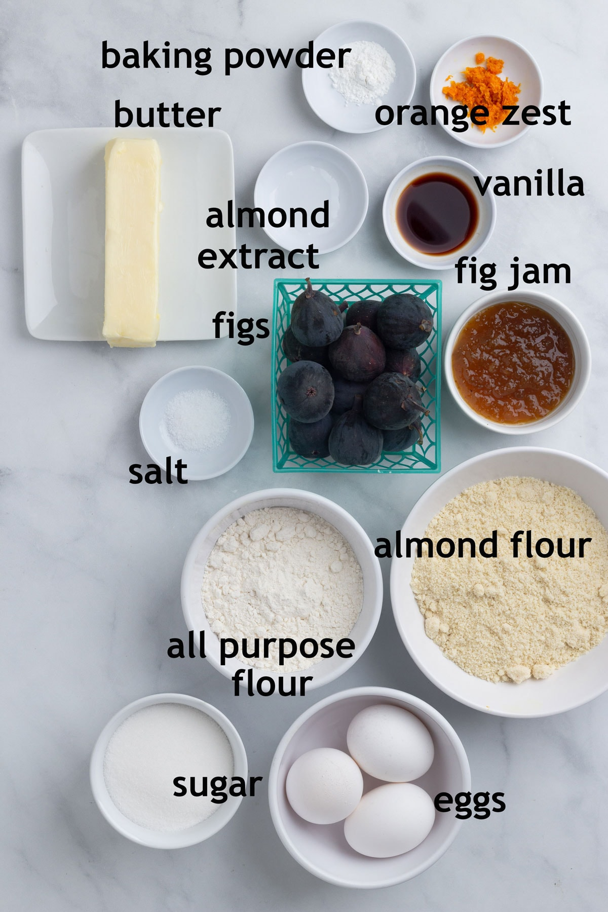 Ingredients with labels including butter, sugar, almond flour, figs, eggs and almond extract.
