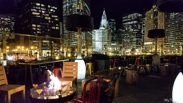 Raised rooftop bar in Chicago is only at 3rd floor but has beautiful panoramic views of Chicago skyline