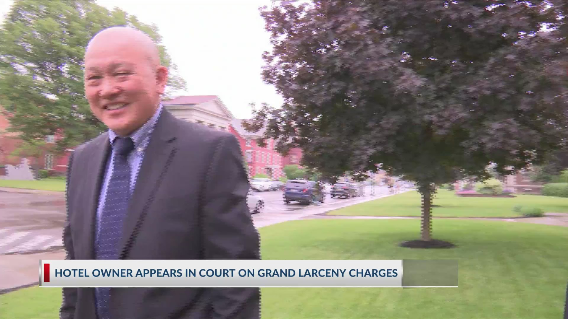 Hotel owner appears in court on grand larceny charges