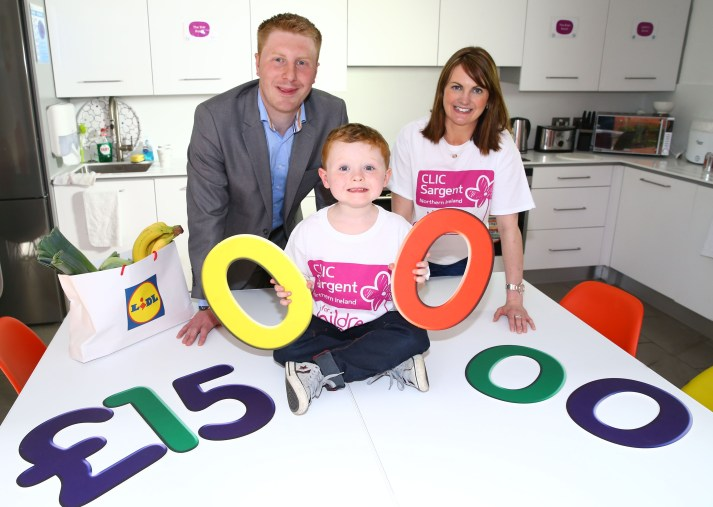 Image: Press Eye Picture shows: Ross Patterson (aged 6) from Ballyclare, Paul Gibson, Sales Operations Executive, Lidl Northern Ireland and Nadine Campbell, CLIC Sargent Area Fundraising Manager are pictured in the CLIC Sargent Home from Home celebrating that Lidl have announced a two year partnership with the charity. Ross and his family have benefited from CLIC Sargent's services since he was diagnosed with Acute Lymphoblastic Leukaemia in February 2014.
