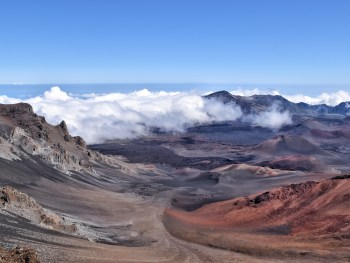 Haleakala Crater on the island of Maui is a unique Hawaiian spot--with an almost lunar landscape and the best stargazing opportunities you will ever find. Watching the sunrise from the summit and biking down the crater is the #1 recommended activity on Maui.