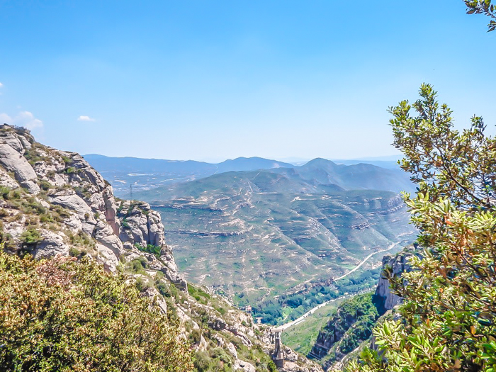 Day trip to Montserrat | 4 days in Barcelona, Spain, Catalonia | Things to do in Barcelona | What to do in Barcelona | Catholic monastery | Catalunya | 1 day in Montserrat | Serrated Mountains | looking down from the cable car