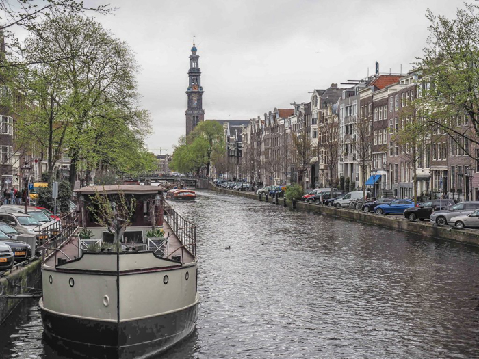 Strolling the canals of the Jordaan during 3 days in Amsterdam, Netherlands | Dutch culture and history | boat life