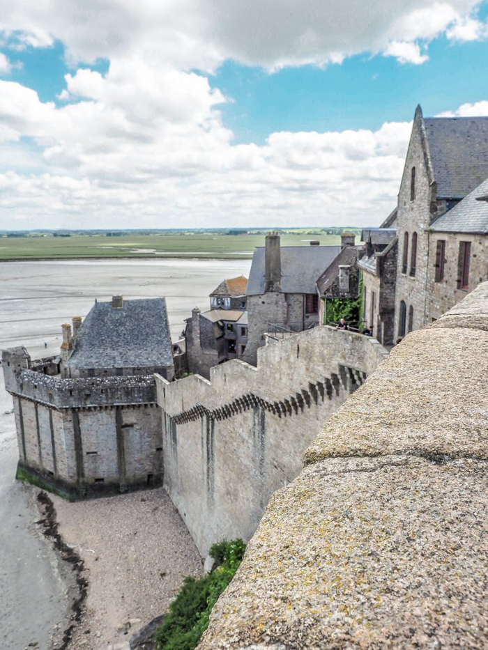 It's actually worth visiting Mont Saint Michel | Normandy, France | Medieval abbey on an island | Bucket list | Disney fairy tale castle inspiration | Mont-St-Michel | wall