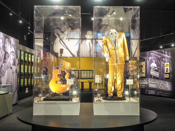 guitar and gold lamé suit | 13 Reasons to Visit Graceland in Memphis, Tennessee even if you're not an Elvis Presley fan #Elvis #Graceland #Memphis #traveltips