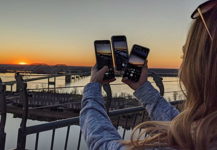Taking pictures of the Mississippi River bridge from the Lookout at the Pyramind   200 things to do in Memphis, Tennessee for first-time visitors - a local's guide #memphis #tennessee #mississippiriver #sunset #goldenhour #traveltips