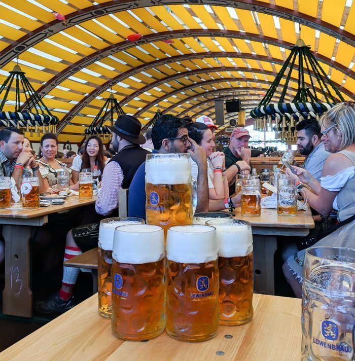 An Oktoberfest Tour Guide's Most Frequently Asked Oktoberfest Questions | Need to know Oktoberfest in Munich, Germany #oktoberfest #munich #germany #beer #festival | beers in the Löwenbräu tent