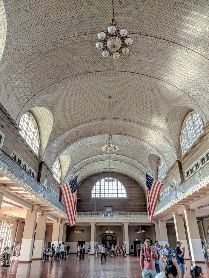 A Time-Budget Traveler's Guide to Visiting Ellis Island in a Hurry   New York City, Manhattan and the Statue of Liberty   United States Immigration Museum   National Park Site #ellisisland #newyorkcity #stateofliberty #nyc #manhattan #ushistory grand hall