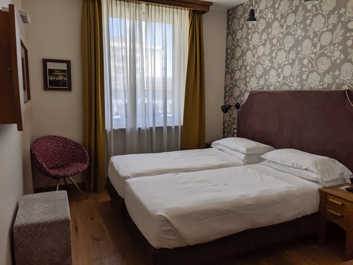 Where to stay in Aosta - the Duca D'Aosta Hotel, bedroom | How to Spend 1 Day in Aosta, Italy // The Capital of the Aosta Valley | Things to see in Aosta, Things to do in Aosta, Where to eat in Aosta, the smallest of Italy's 20 regions #aosta #italy #aostavalley #traveltips #timebudgettravel