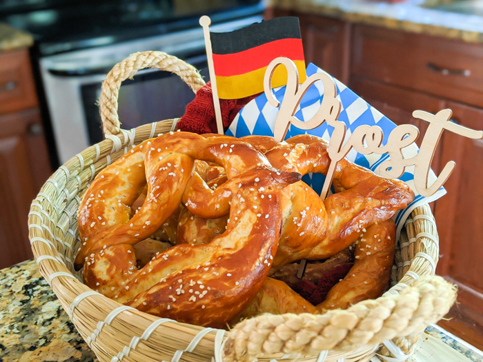 bavarian pretzels in a basket with a german flag