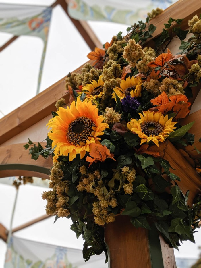 How to decorate for an Oktoberfest party at home: sunflower decorations inside the Hofbrau tent